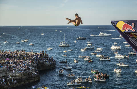 Jonathan Paredes of Mexico dives from the 27.5 metre platform during the seventh stop of the Red Bull Cliff Diving World Series, Polignano a Mare, Italy on September 13th 2015.